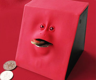 Teach your children the horrifying lessons of financial responsibility with the creepy coin eating bank. This traumatizing device features an anthropomorphic abomination that devours coins while the lifeless doll-like eyes stare directly into your soul.