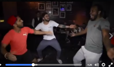 RCB players celebrated their sensational deVilliers-powered victory over Gujarat Lions late into the night.  In the hotel, Mandeep Singh taught Chris Gayle, who never misses a chance to dance, a few bhangra moves. He later invited Virat Kohli to join in and he did that in style, striking a charming rhythm.