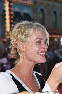Rebecca Romijn signing autographs at the Pirates of the Caribbean premiere