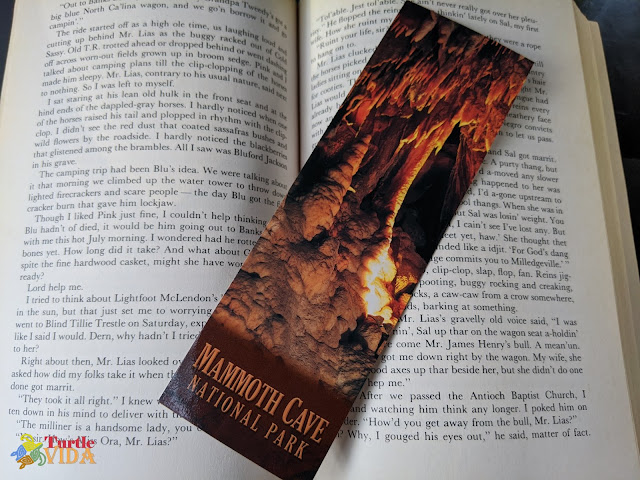 Open book with a bookmark from the Mammoth Cave National Park