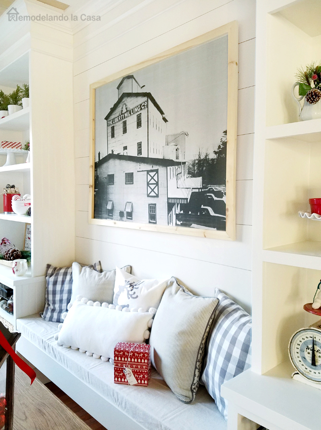 red and white decor in dining room with planked wall, bench, built-ins and black and white wall art