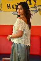 Eesha in a cute deep neck top and Skirt at at Big FM 070.JPG