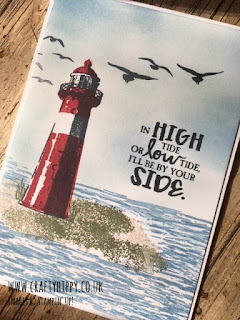 A greetings card showing a lighthouse scene complete with red lighthouse, stormy sea and flying birds, all stamped with the High Tide stamp set by Stampin' Up!
