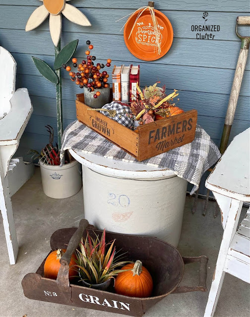 Photo of rustic fall decor on the covered patio.