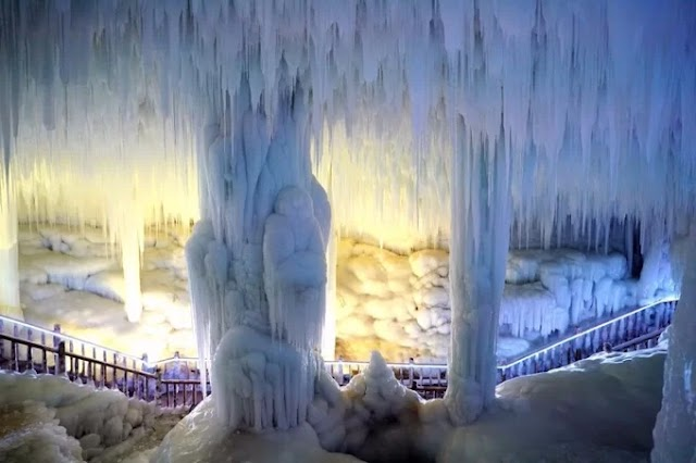 Magical ice stalactites in a cave frozen around the year