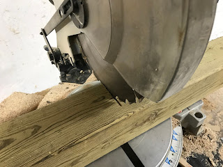 Cutting the post into 2 foot sections