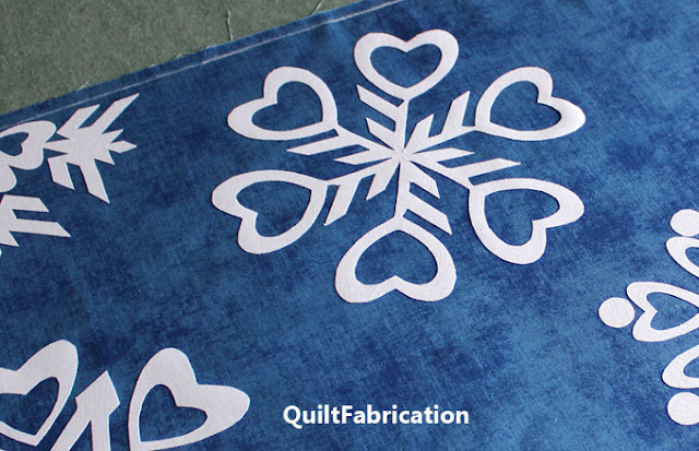 one white heart themed snowflake