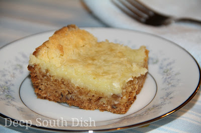 Wash Day Cake, or Gooey Butter Cake as it is more well known, is a simple cake using cake mix to form a crust and topped with a powdered sugar and cream cheese filling.