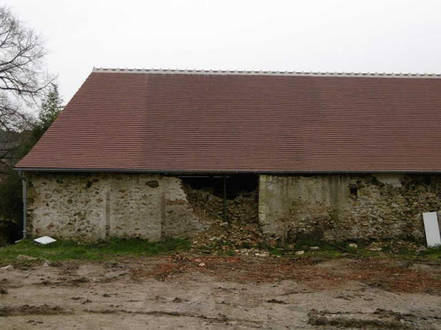 New tile roof on an old limestone barn.  Indre et Loire, France. Photographed by Susan Walter. Tour the Loire Valley with a classic car and a private guide.