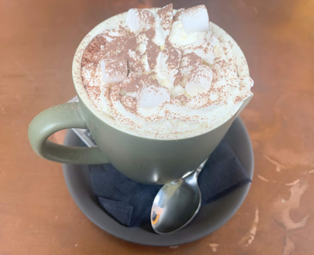 mug of hot chocolate with cream an marshmallows