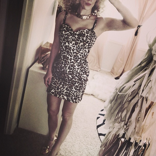 leopard dress, gold accessories, big hair