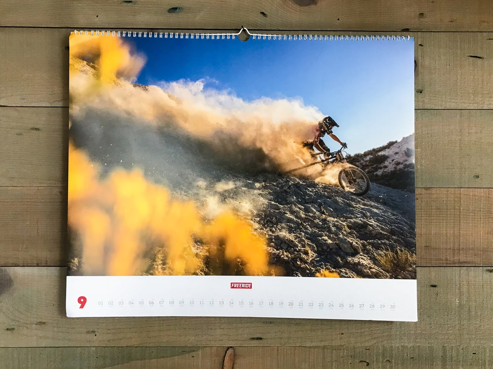 Mountain biker and personality Cam McCaul bikes in a super dusty area in the desert, this photo made a calendar print.