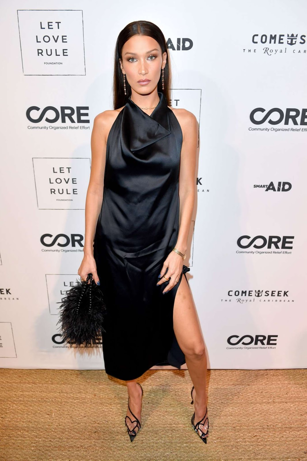 Bella Hadid is braless and backless for the Core x Let Love Rule Benefit during Miami Art Basel