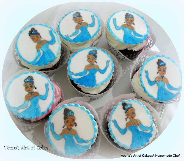 Cupcakes toppers with a princess Tiana theme.