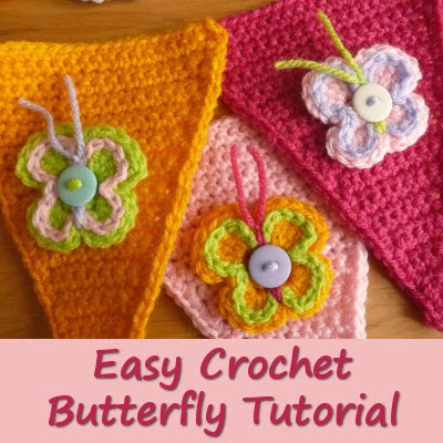 Colored crocheted butterfly motifs with button and yarn detail