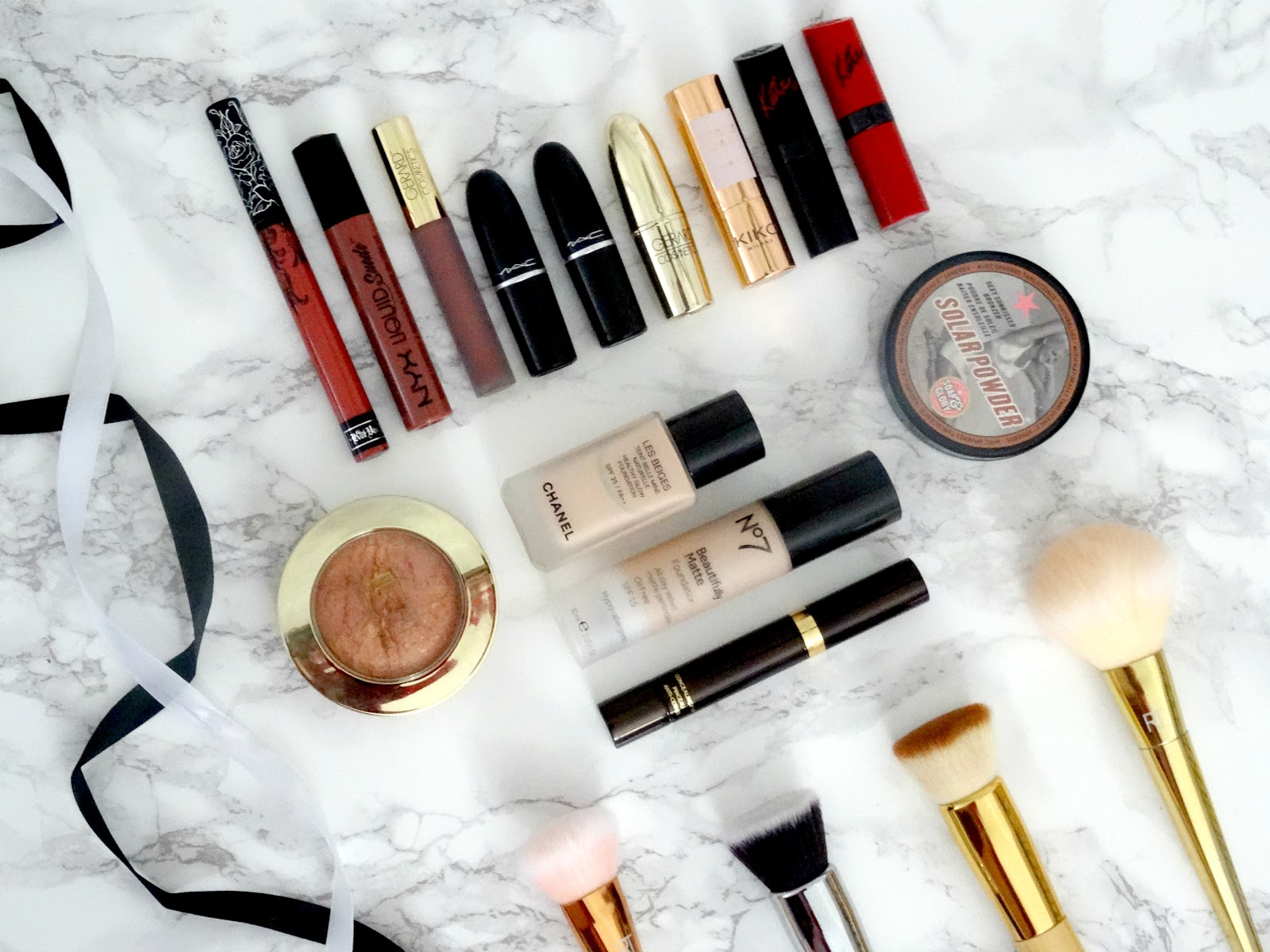 An array of highend and drugstore makeup