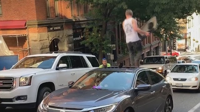 Man rips sunroof off car, attacks parking enforcement officer in Seattle