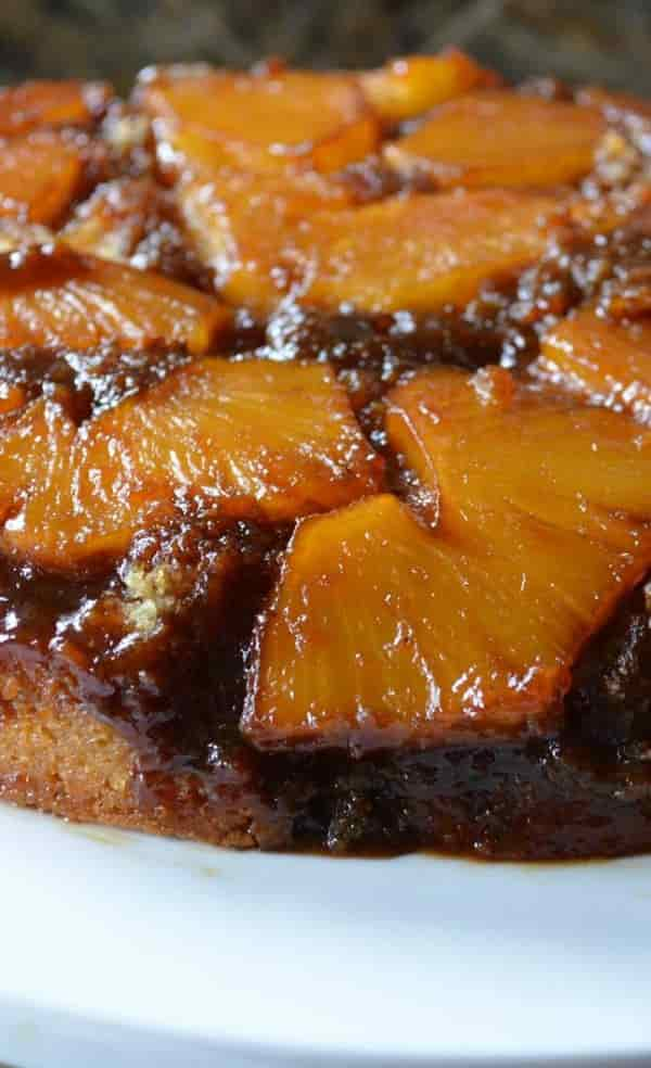 Pineapple Upside Down Cake From Scratch recipe is a favorite dessert recipe. The fresh pineapple on top and in the cake makes this the most delicious dessert recipe. This is always a favorite at Christmas from Serena Bakes Simply From Scratch.