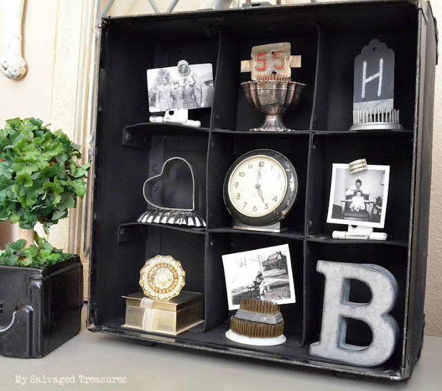 repurposed pay phone coin box carrier turned into display cubbies