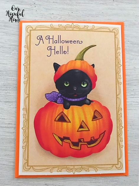 A Halloween Hello greeting card black cat jack-o-lantern
