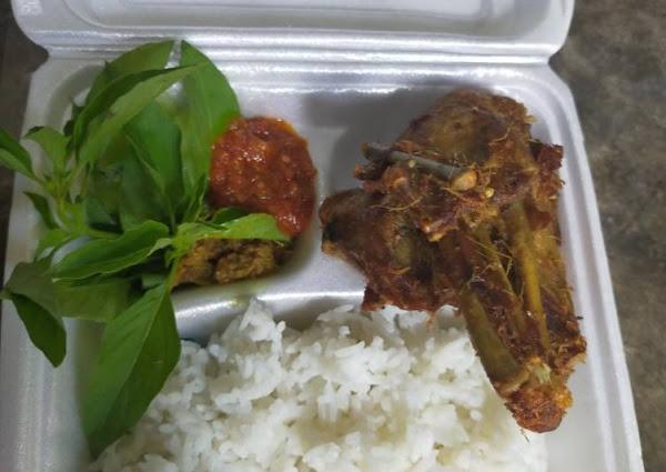 Nasi bebek bumbu kuning with sambal terasi..
