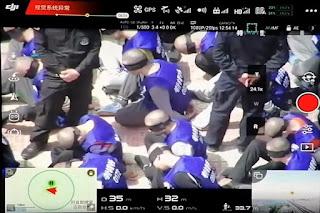 Video Drone: Ratusan Muslim Uighur Ditutup Matanya dan Digiring Polisi China