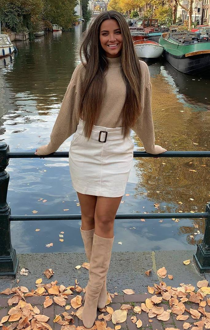 what to wear on thanksgiving day : beige sweater + white skirt + over knee boots