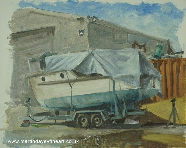 old boat painting sat on trailer