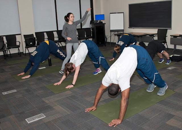 Students doing yoga exercises