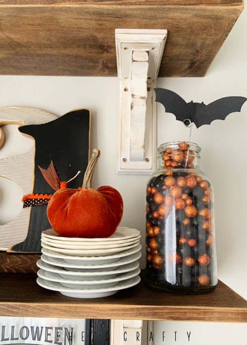 Halloween Home Decor - shelf styling, vintage dishes, velvet pumpkin