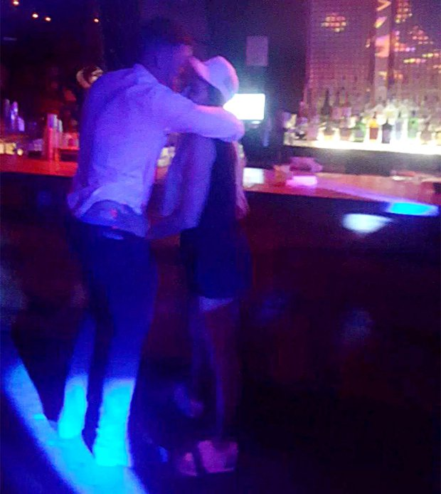 'Wasted' Katie Price gets close to mystery man in Miami bar after vowing to go sober