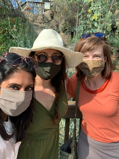three women wearing face masks