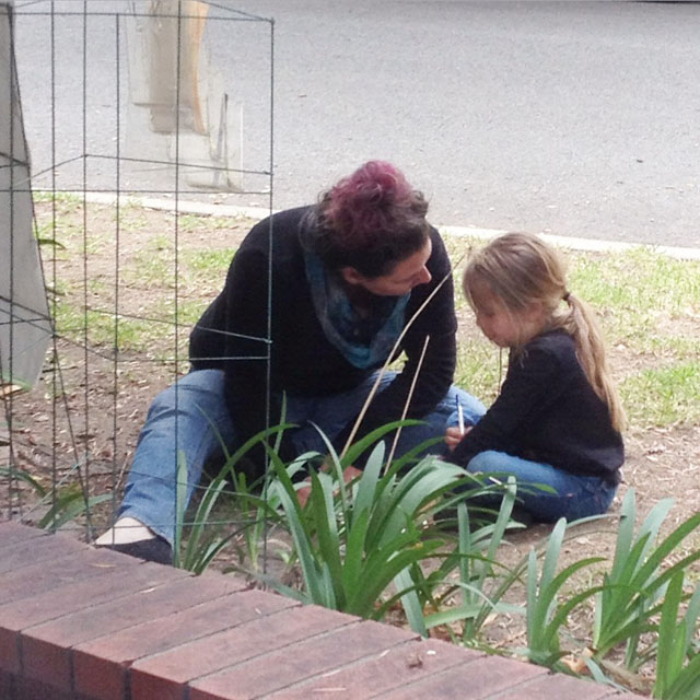 Mom and daughter at our neighborhood Gratitude Tree