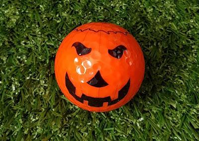 A Halloween pumpkin golf ball from UrbanCrazy