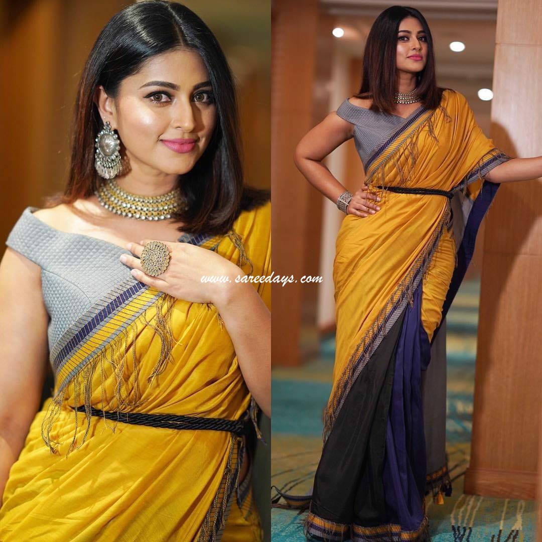Latest saree designs sneha in yellow and blue half and half saree checkout sneha in yellow and blue half and half designer saree paired with matching blouse altavistaventures Images