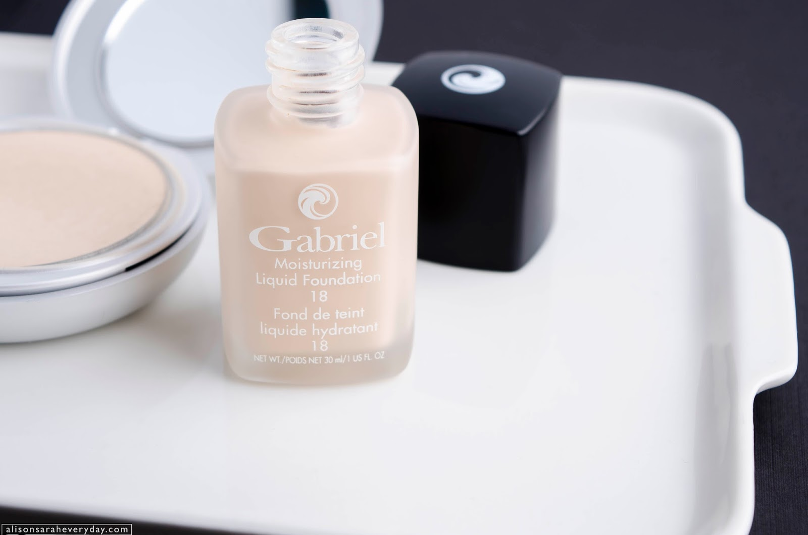 Gabriel Cosmetics Liquid Foundation and Zuzu Luxe Powder Foundation on a white dish