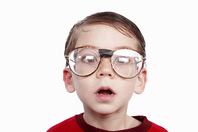 child with big glasses and amblyopia