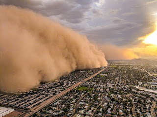 Aerial view of a giant dust cloud bearing down on housing tracts. Photo by Jason Ferguson