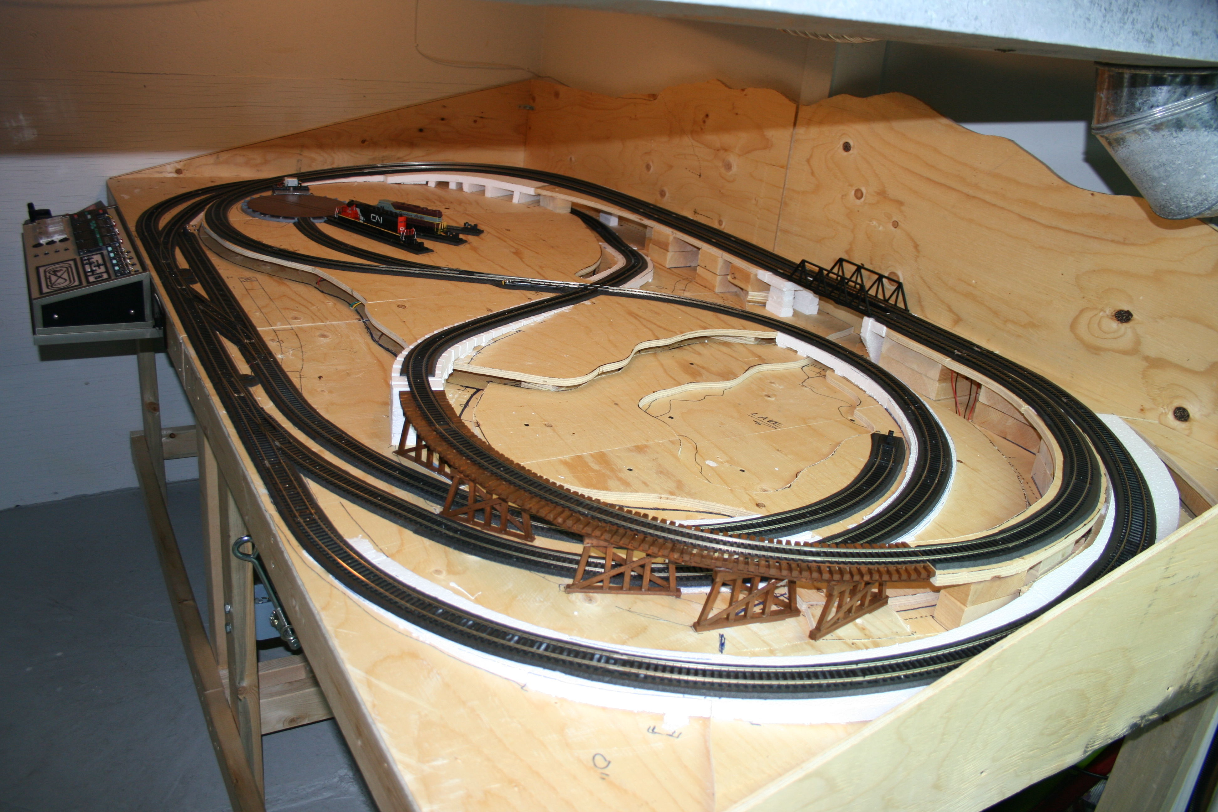 4 x 8 HO scale model railroad benchwork with completed track and control panel
