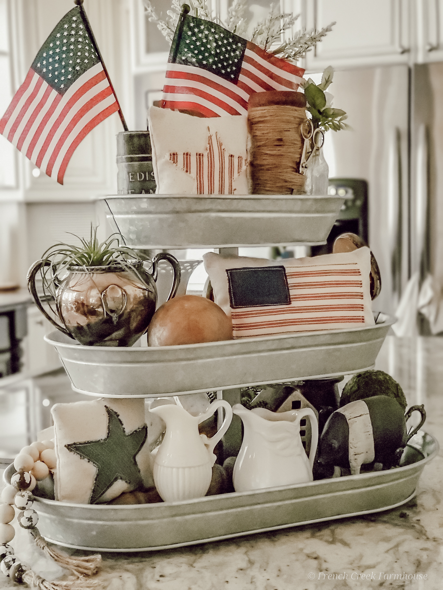 Patriotic themed tiered tray on kitchen island
