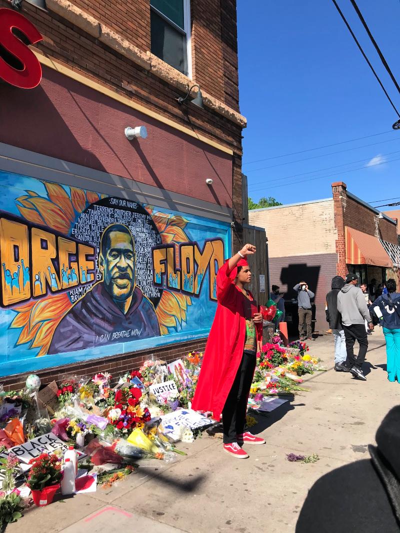 2020 Graduate in front of George Floyd Mural