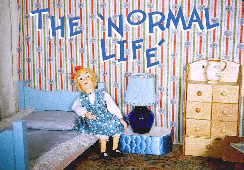 the normal life, photograph of a doll in a miniature bedroom
