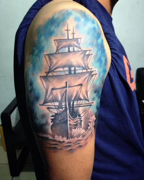 4aa20b15a You can use sky blue watercolour or ink to give the impression of clear sky  in your ship tattoo design just like this.