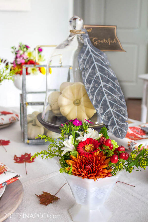 galvanized feather and bright floral centerpiece