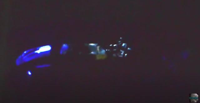 Sideways view of the UFO with the Alien Grey inside it.