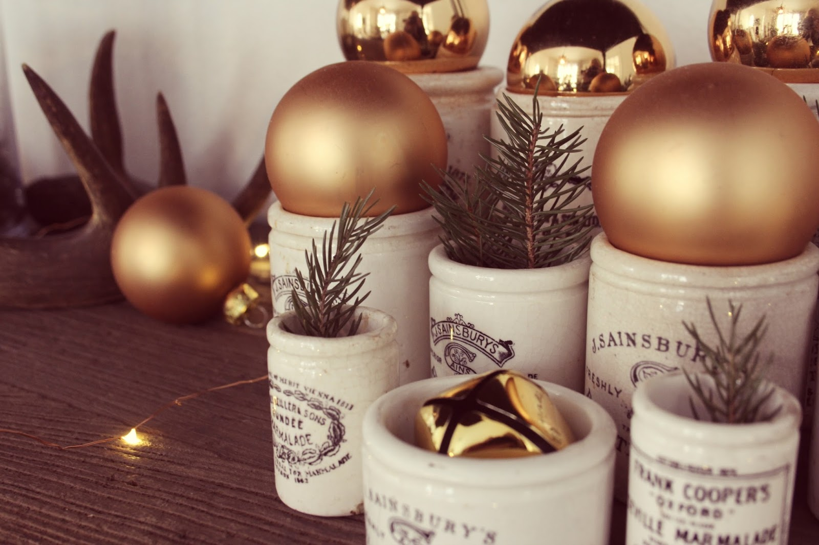 Vintage English crocks with gold balls and greenery for Christmas decor - Hello Lovely Studio