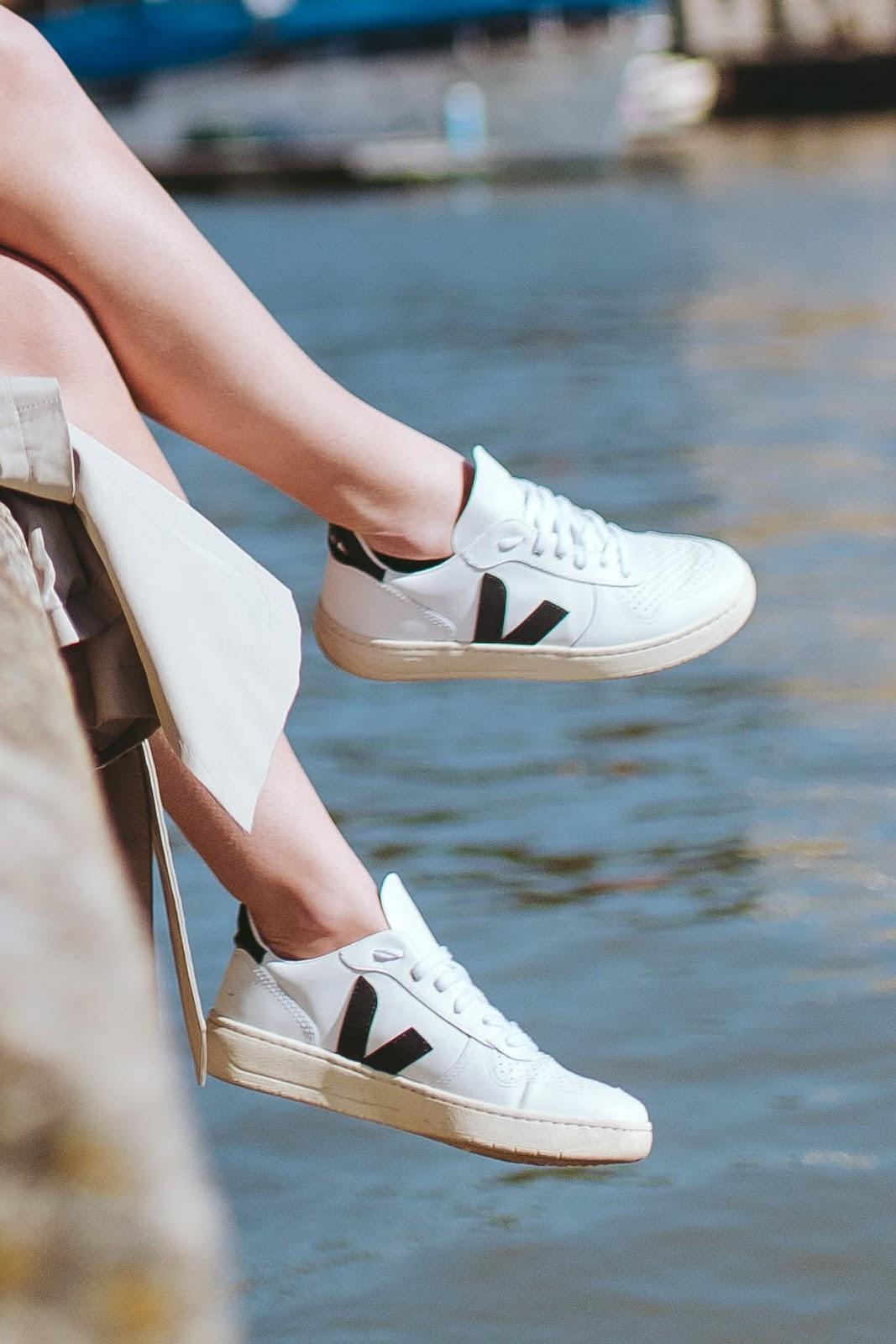 Rachel Emily wearing white Veja Esplar sneakers at Bristol Harbourside