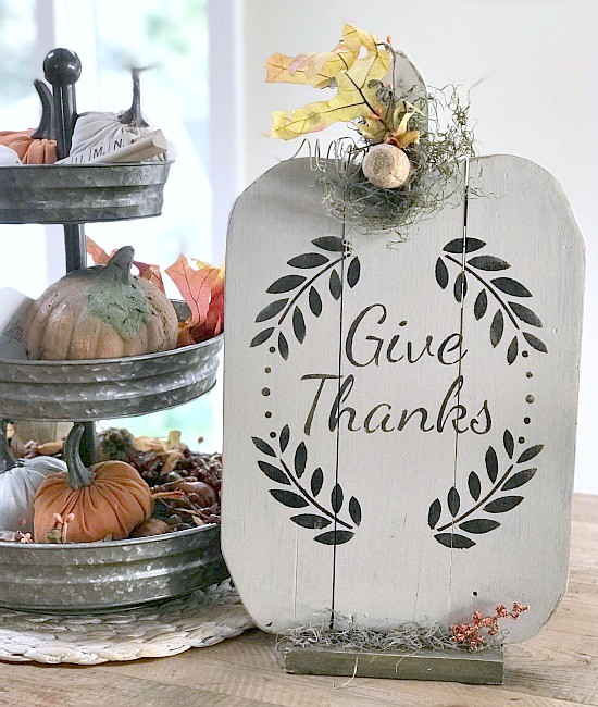 White pumpkin pallet with wreath and give thanks stencil