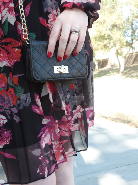 quilted bag and pleated floral dress