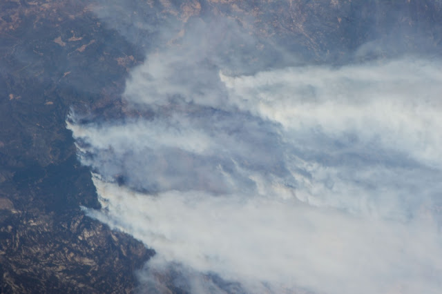 One of the Expedition 36 crew members aboard the Earth-orbiting International Space Station photographed massive smoke plumes from the California wildfires Aug. 29. Image Credit: NASA